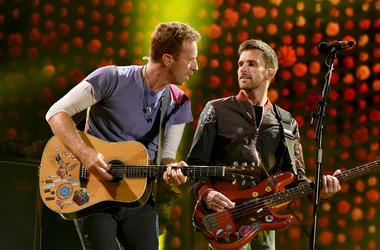 Chris Martin (L) and Guy Berryman of Coldplay perform at the Rose Bowl on October 6, 2017