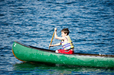 child rows in a canoe