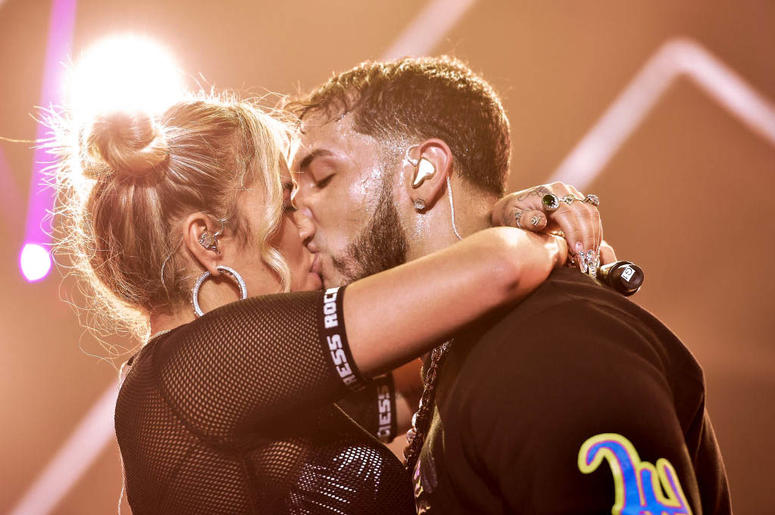 Karol G and Anuel AA kiss live on stage during their concert at United Palace Theater on November 17, 2018 in New York City.
