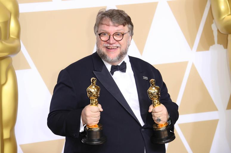 Guillermo del Toro poses with his awards for Best Picture for Best Director for The Shape of Water in the photo room during the 90th Academy Awards at Dolby Theatre.