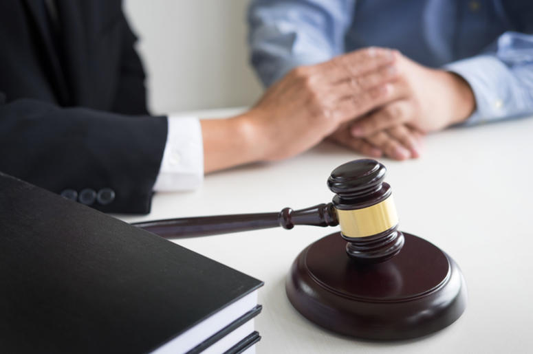 a lawyer meets with a client