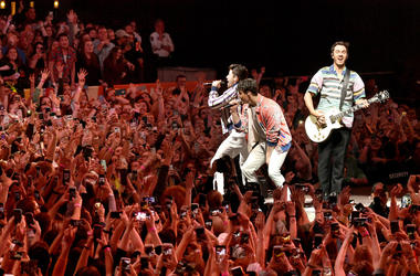 Nick Jonas, Joe Jonas, and Kevin Jonas of the Jonas Brothers perform onstage at the March Madness Music Series featuring Jonas Brothers presented by Coca-Cola during the NCAA March Madness Music Series at The Armory on April 06, 2019 in Minneapolis, MN
