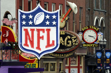 NFL neon sign joins the permanent ones along Broadway as preparation continues for the NFL Draft Tuesday, April 23, 2019, in Nashville, Tenn
