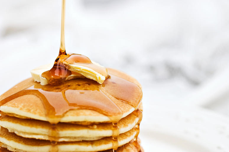 Syrup on stack of pancakes