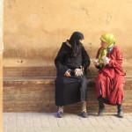 Two muslim women are talking in the street_350274818