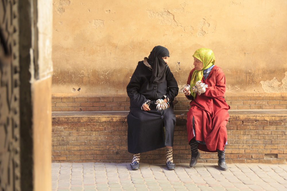Two muslim women are talking in the street_350274818