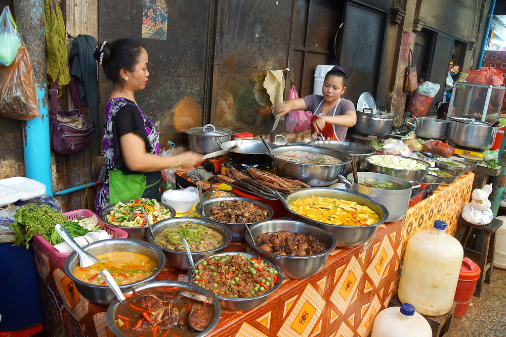 Woman cooking lunch in the market of Siem Reap_314608583