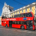 Sightseeing bus in Praca Comercio_383298082