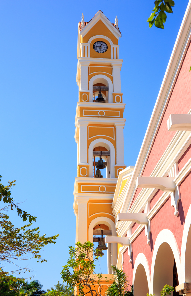Bell tower of old Spanish church near Playa del Carmen_221738887