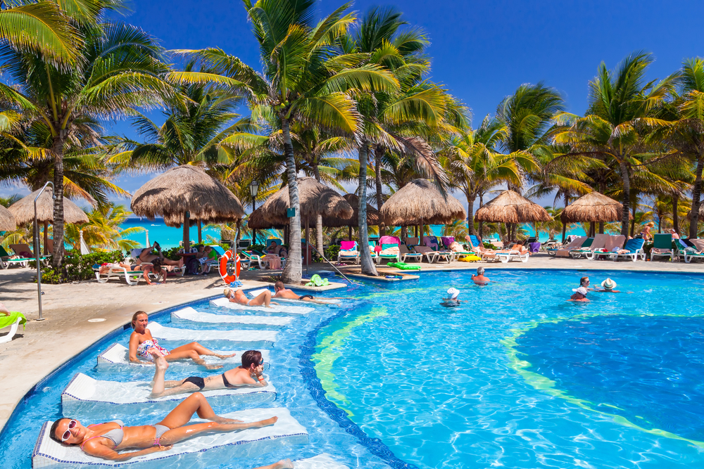 luxury swimming pool at RIU Yucatan Hotel in Playa del Carmen_389436862