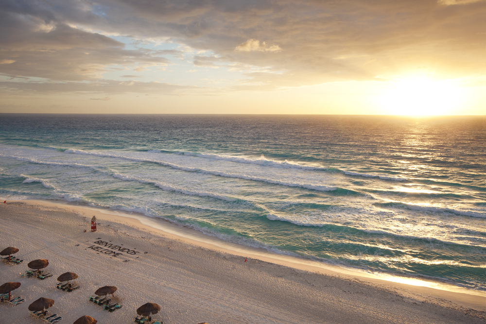 Beautiful sunrise on the beach in Cancun_383640985