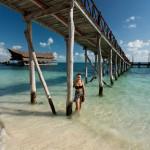 Beautiful woman on the Cancun beach_305342480