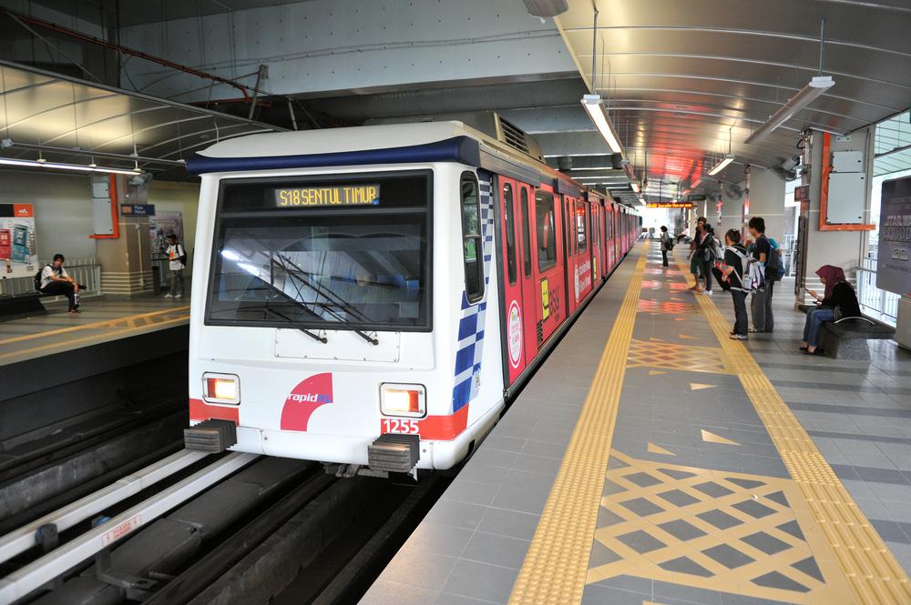 RapidKL LRT train departs Plaza Rakyat station_96441515
