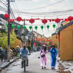 vietnamese clothes walk on a street in Hoi Ah_292234319