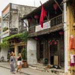 Tourists in the streets of Hoi An ancient town_393748555