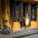 Girl in traditional Vietnamese dress in the Hoi An shop_386523073