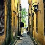 between buildings in Hoi An_385642570