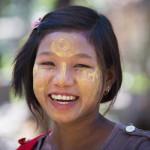 Myanmar girl with thanaka_383339887
