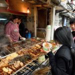 Chinese people trades traditional food_406875322