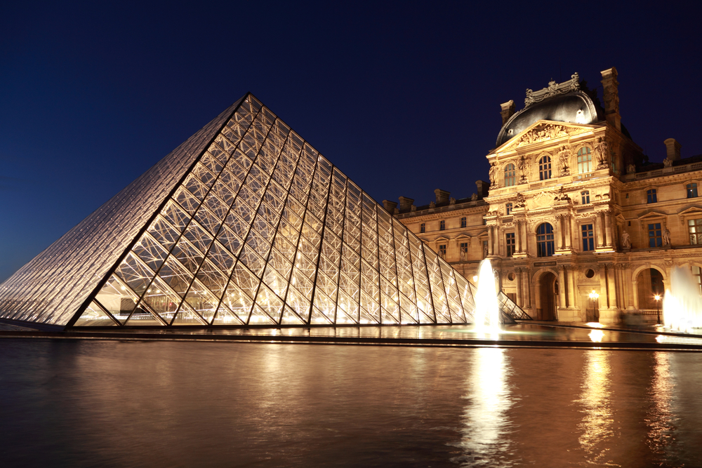 Louvre Pyramid and Pavillon Rishelieu in the evening_77642530