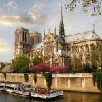 Notre Dame with boat on Seine, France_74901310
