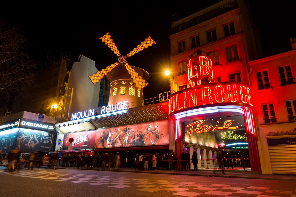 World famous cabaret club the Moulin Rouge at night in Paris_367606727