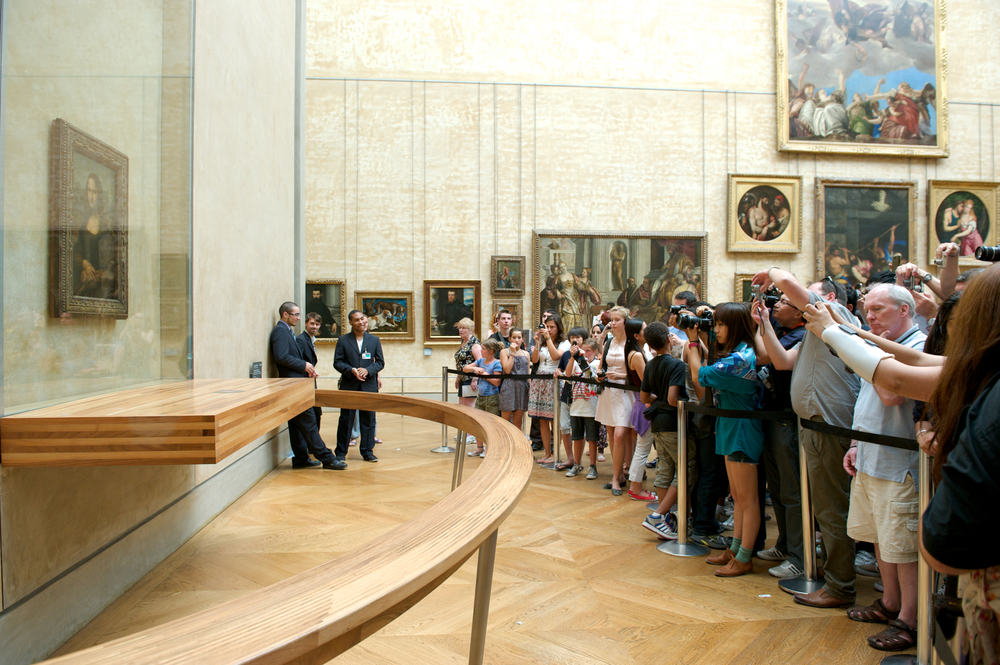take photo of Leonardo Da Vinci Mona Lisa at the Louvre Museum_87317236