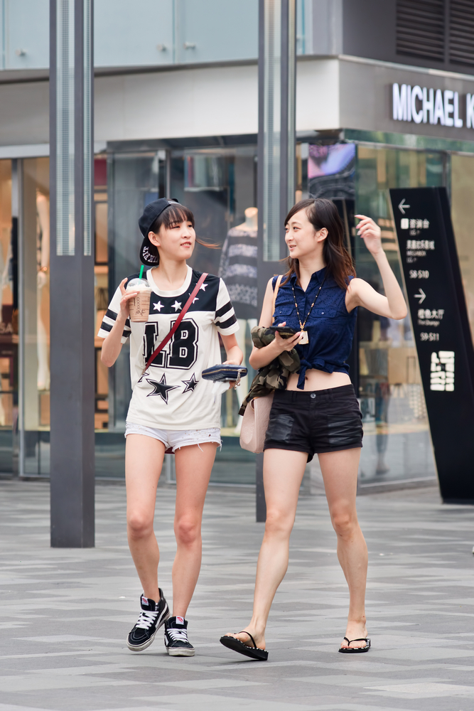 Beijing Fashionable girls at the Village shopping area_279279728