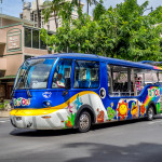 Colorful tourist bus on Kalakaua avenue in Waikiki_191692820