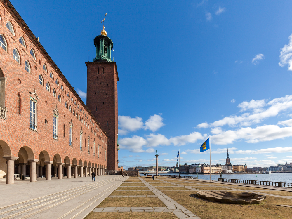 Stockholm City hall and its waterfront yard_385172047