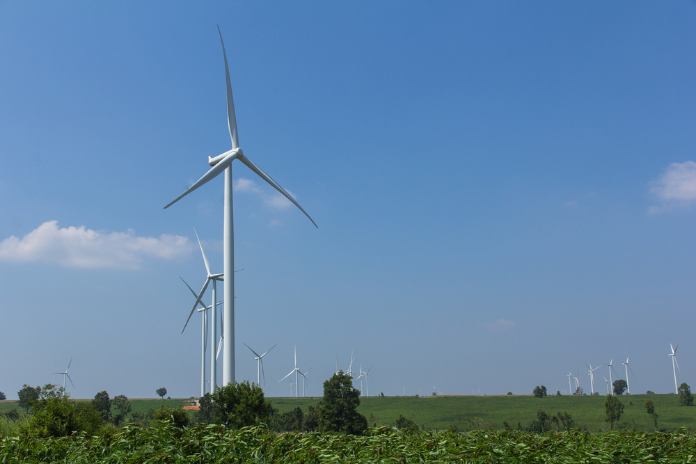 Electrical Eco power maker wind turbine in cassava farm_393858703