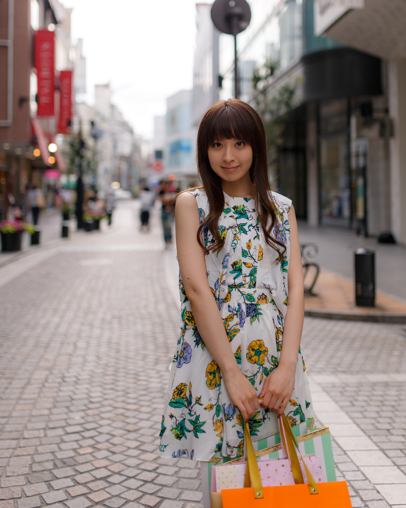 Japanese girl standing in shopping street in Yokohama_287033333
