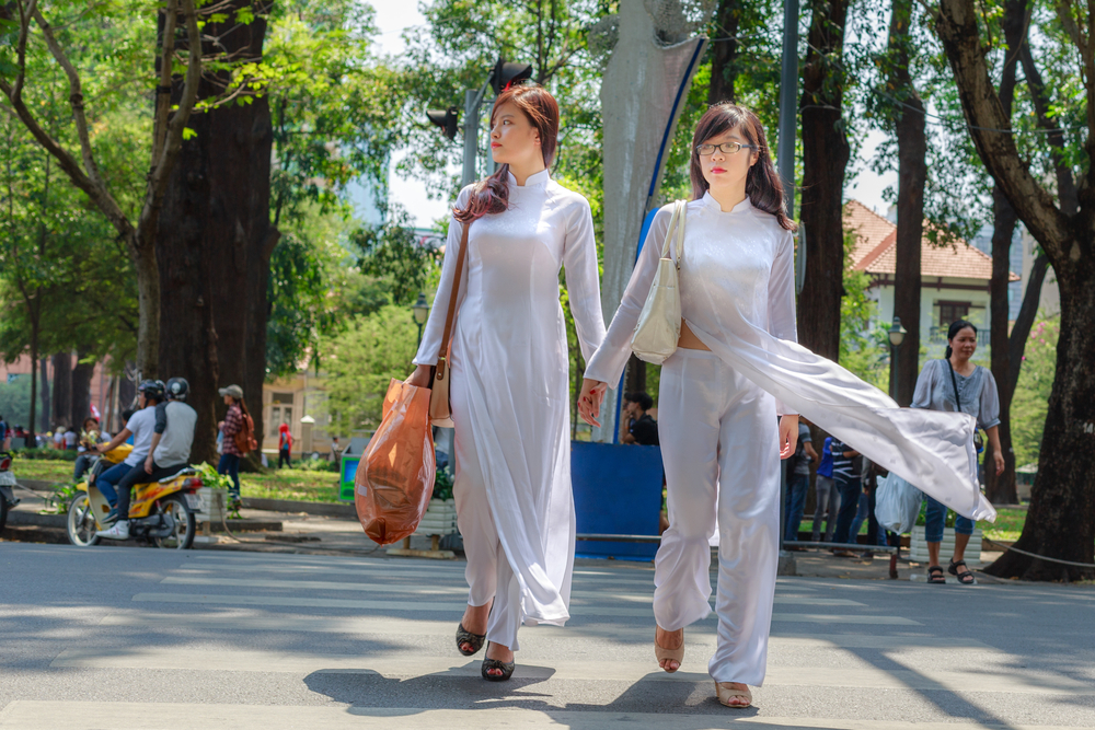 white Ao dai on the street_274780880