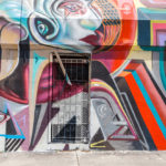 Graffiti art on wall in graffiti design district Wynwood _324110141