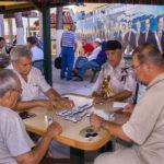 Elderly Cuban men play dominoes at Gomez Park_341167874