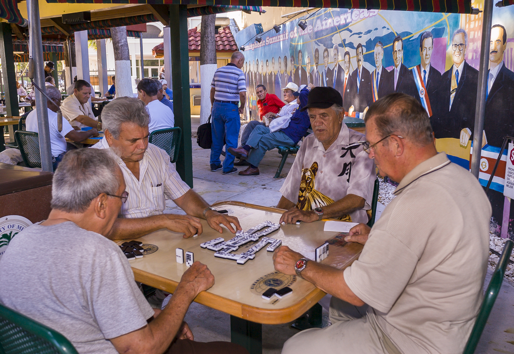 Elderly Cuban men play dominoes at Gomez Park_341167874