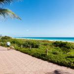 Miami Beach with beach goers along the promenade_383847157