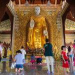 praying inside the Dhammikarama_179746655