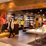 Shoppers are seen at a Nike store_169464884