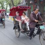 Tourists in a rickshaw_288013088
