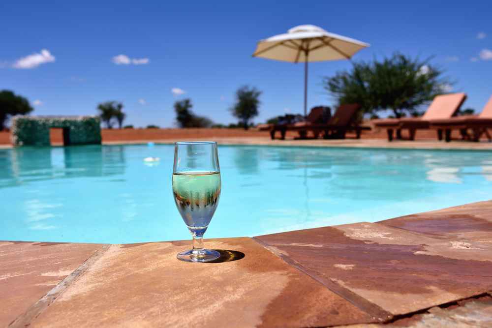 swimming pool in the middle of Kalahari Desert_374733742