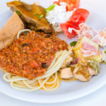 Spaghetti Bolognese with a Greek salad in Bali_436521166