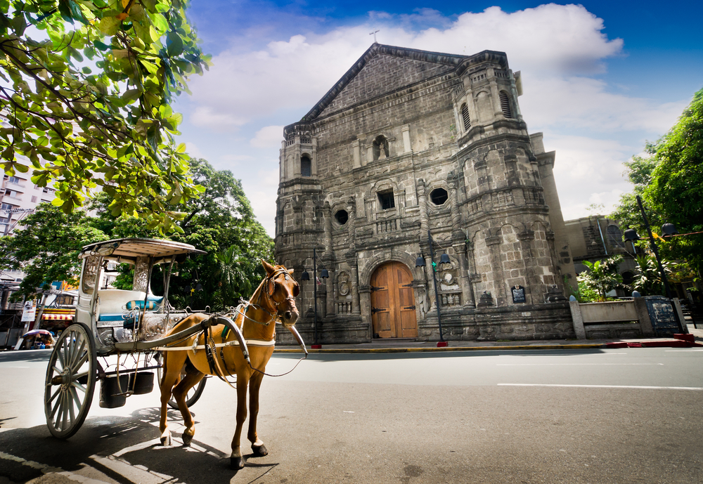 Horse Drawn Carriage parking in front of Malate church _140268766