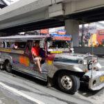Jeepney on the street in Manila_374232394