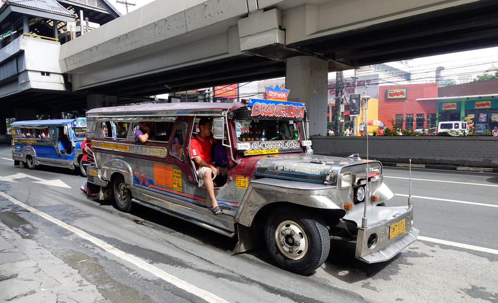Jeepney on the street in Manila_374232394
