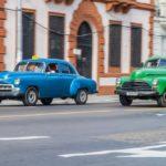 Vintage cars ride on the street in Havana_445236724