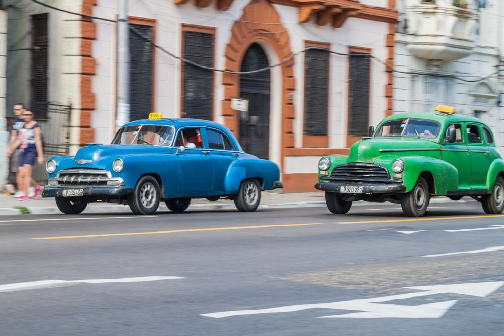 Vintage cars ride on the street in Havana_445236724