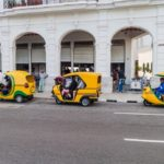coco taxis in the center of Havana_444850783