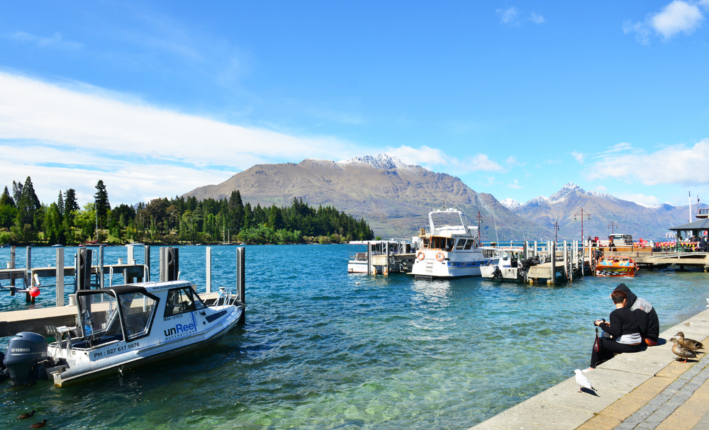 Ferries waiting at jetty of Lake Wakatipu, Queenstown_328099121