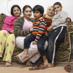 Egyptian family during riots in Cairo_174799580